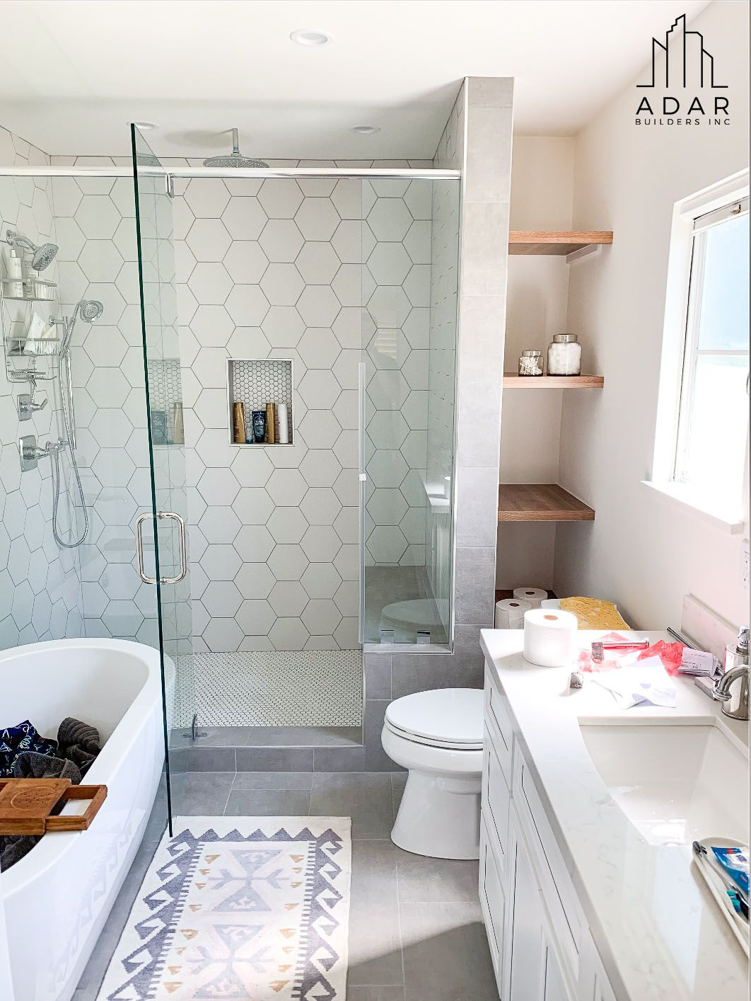a white bathroom design with mixed white tile shower walls on bathroom renovation ideas white id=29647