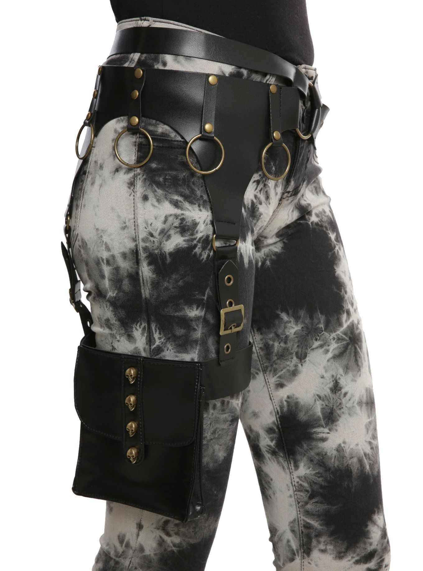 2336e3fadfd The black faux leather leg belt has gold tone brads and belt loops