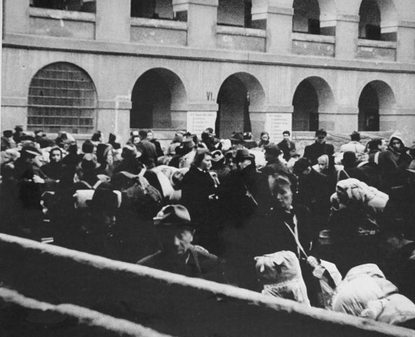 A rather innocuous picture of Dutch Jews arriving at Theresienstadt.  Though technically a Concentration and Transport Camp, tens of thousands of people died at Theresienstadt of disease, starvation, and brutality.  Unlike other camps, Theresienstadt held mostly political prisoners of Dutch, Polish, Russian, Czech, and other nationalities.  Most Jews were at Theresienstadt for only a short time before being transported to an Extermination Camp.