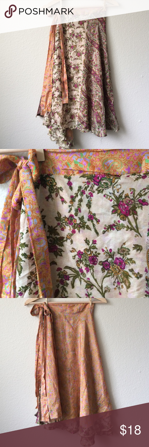Vintage reversible flower power wrap skirt. Adorable, and reversible, this skirt goes to the mid calf. Reversible, printed silks on either side. Dress it up or down. This skirt is one size fits all, since you wrap it to fit your waist. Free People Skirts Circle & Skater