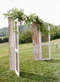 Wedding arch, buy two really old doors or else just by doors and distress them (good project for me) and then connect them with a piece of ply wood so it will stand and then cover the wood with flowers or babies breathe! lol ----I love this!!!  Then the doors could decorate the home afterwards or something.  Love it and love doors :) #Cake