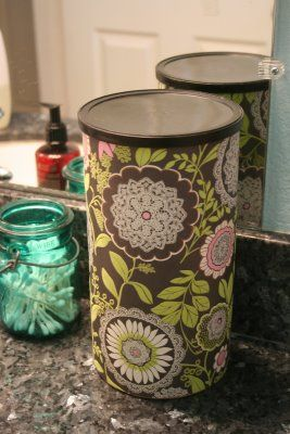 Mod-podge scrap book paper to old canisters & use for organizing various items.