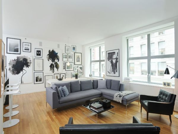 black, grey, white lounge room with natural wood floor