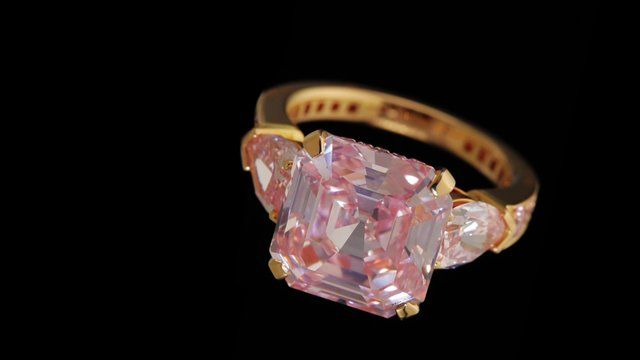 An incredibly rare 9.07ct Fancy Intense Pink emerald cut diamond ring. For a further mark of rarity, the exquisite central stone is complimented beautifully by two Fancy Intense Pink pear shape shoulders and a pink pavé diamond band.  #graffdiamonds #pinkdiamond #diamond #highjewelry #ring