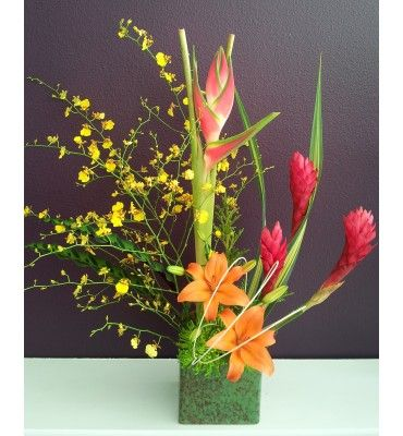 Pical Arrangement With Yellow Oncidium Orchids Red Ginger And Orange Lilies In Stylish Ceramic Cube Flower Arrangements Flower Delivery Orchid Arrangements