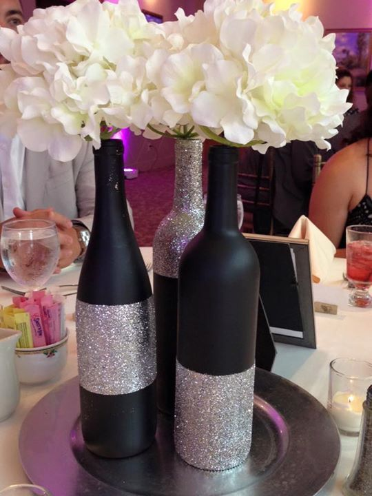 Black chalkboard paint and silver glitter centerpieces for Decorating wine bottles with glitter