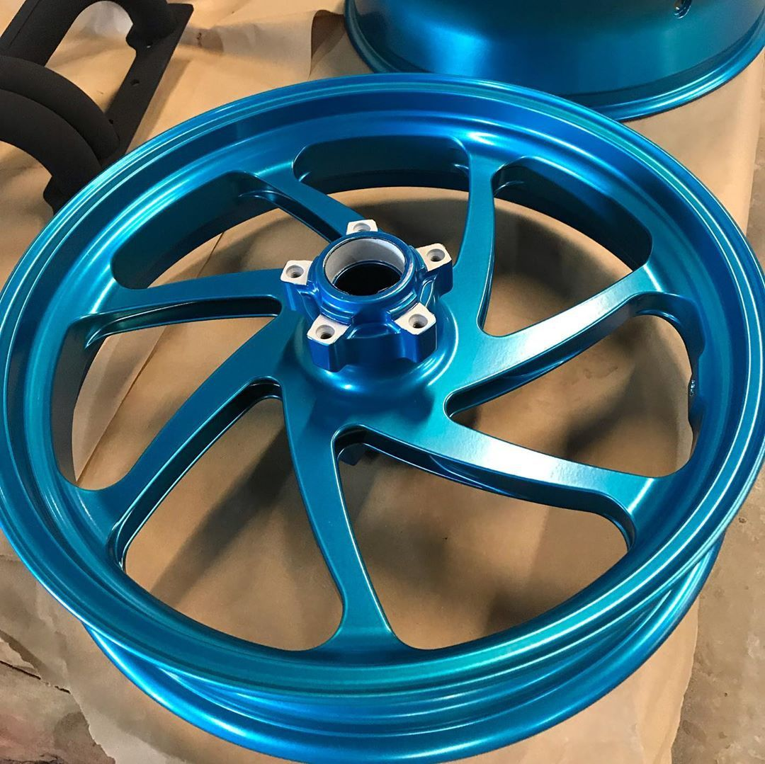"""Motor cycle wheels done in """"anodized lite blue"""". This uses"""