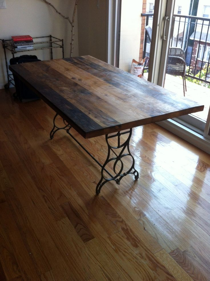 Really cool dining table made from antique sewing machine for Really cool dining tables