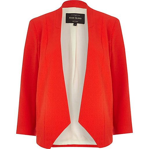 In a neat cut and eye-catching shade, this bright red open front blazer is the ideal transitional cover-up. Featuring a collarless design and inverted waterfall shape.