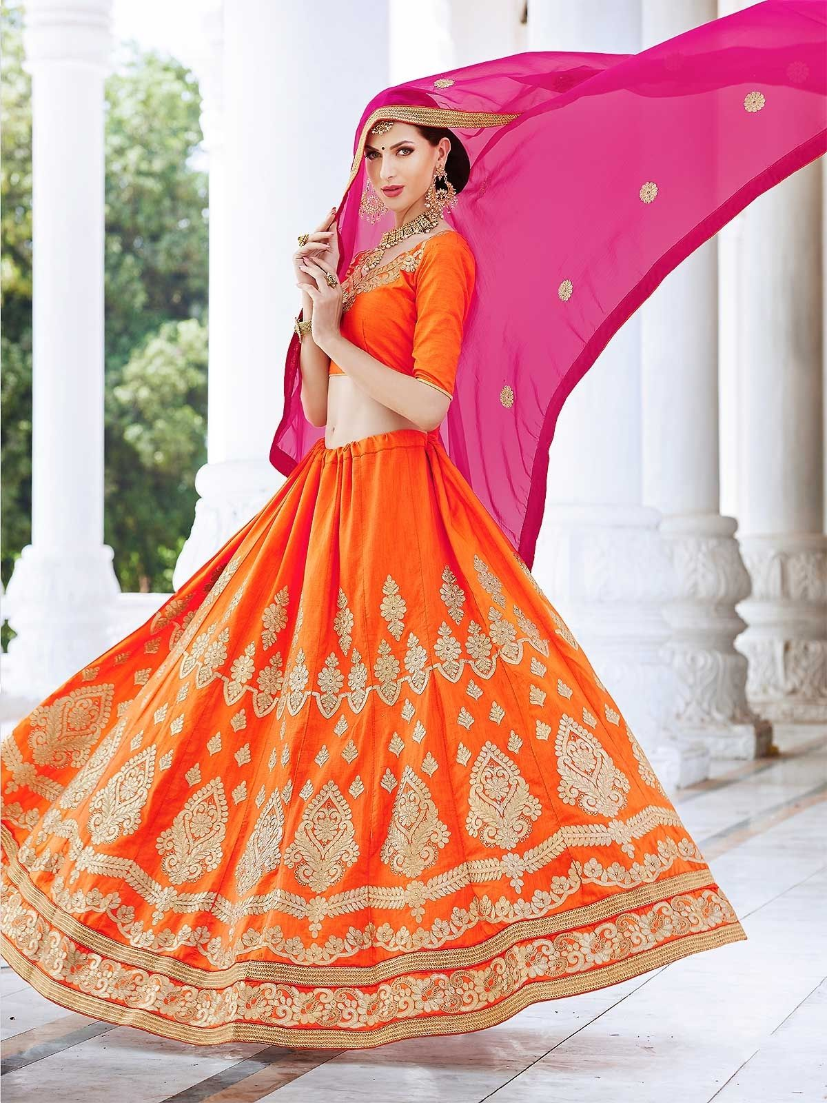 2b01190f72 Shop orange embroidered flared lehenga from wide range of colorful designer  orange lehengas at ZaraaFab online store. Find out the wide variety of  designer ...