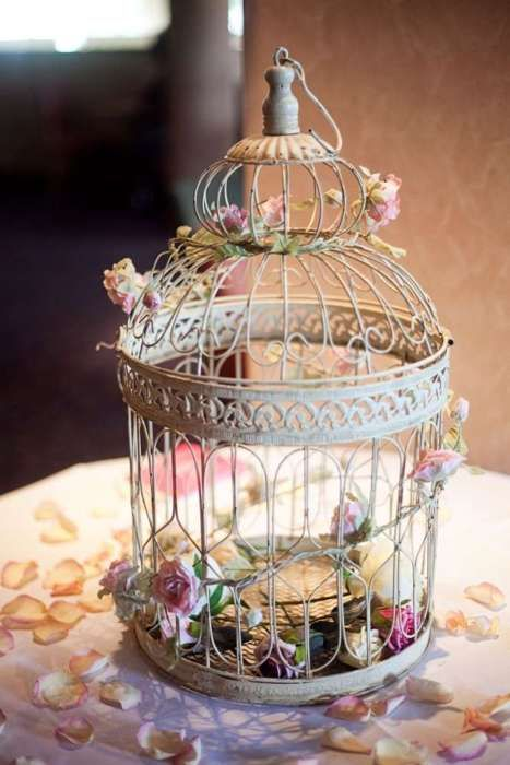 Birdcage Centerpiece With Those Fake Flowers On Wire Used For