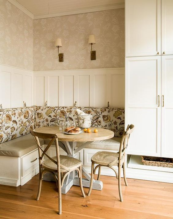 cottage breakfast nook features an l shaped built in banquette with storage drawers adorned with