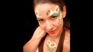 Daisy Flowers Face Painting Tutorial, via YouTube.
