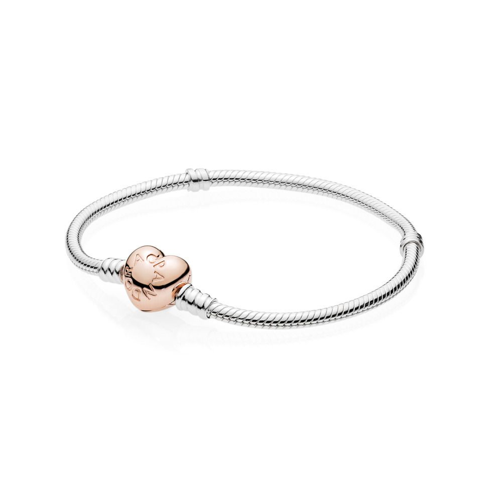 PANDORA's classic sterling silver charm bracelet is updated with a PANDORA Rose blush-pink heart-shaped clasp. With a nod to romance, this stylish bracelet matches every metal colour and is the perfect carrier for your personal edit of charms.