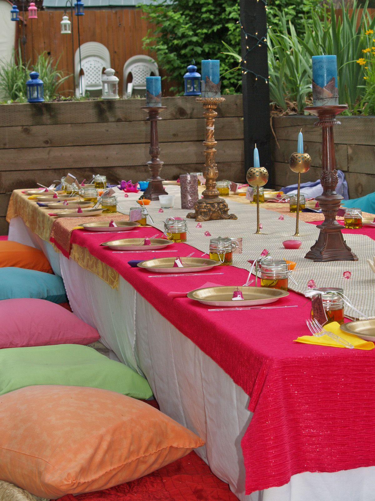 diy moroccan themed backyard bridal shower floor seating orange pink white blue purple draping olive oil favors