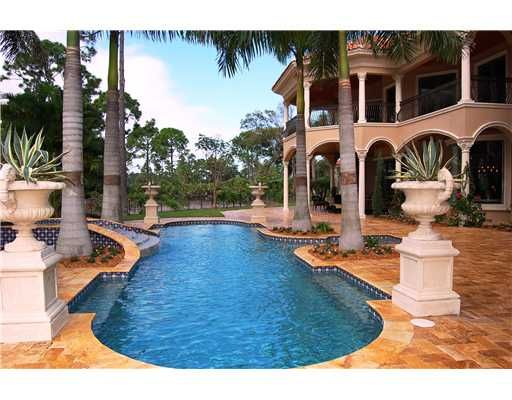 Pool at luxury Old Palm Golf Country Club - golf course estate for sale and for rent