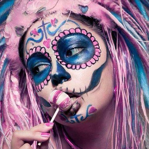 Girl With Pink Hair Day Of The Dead Face Makeup Holding A Lollipop Sugar Skull Girl Sugar Skull Makeup Sugar Skull Art
