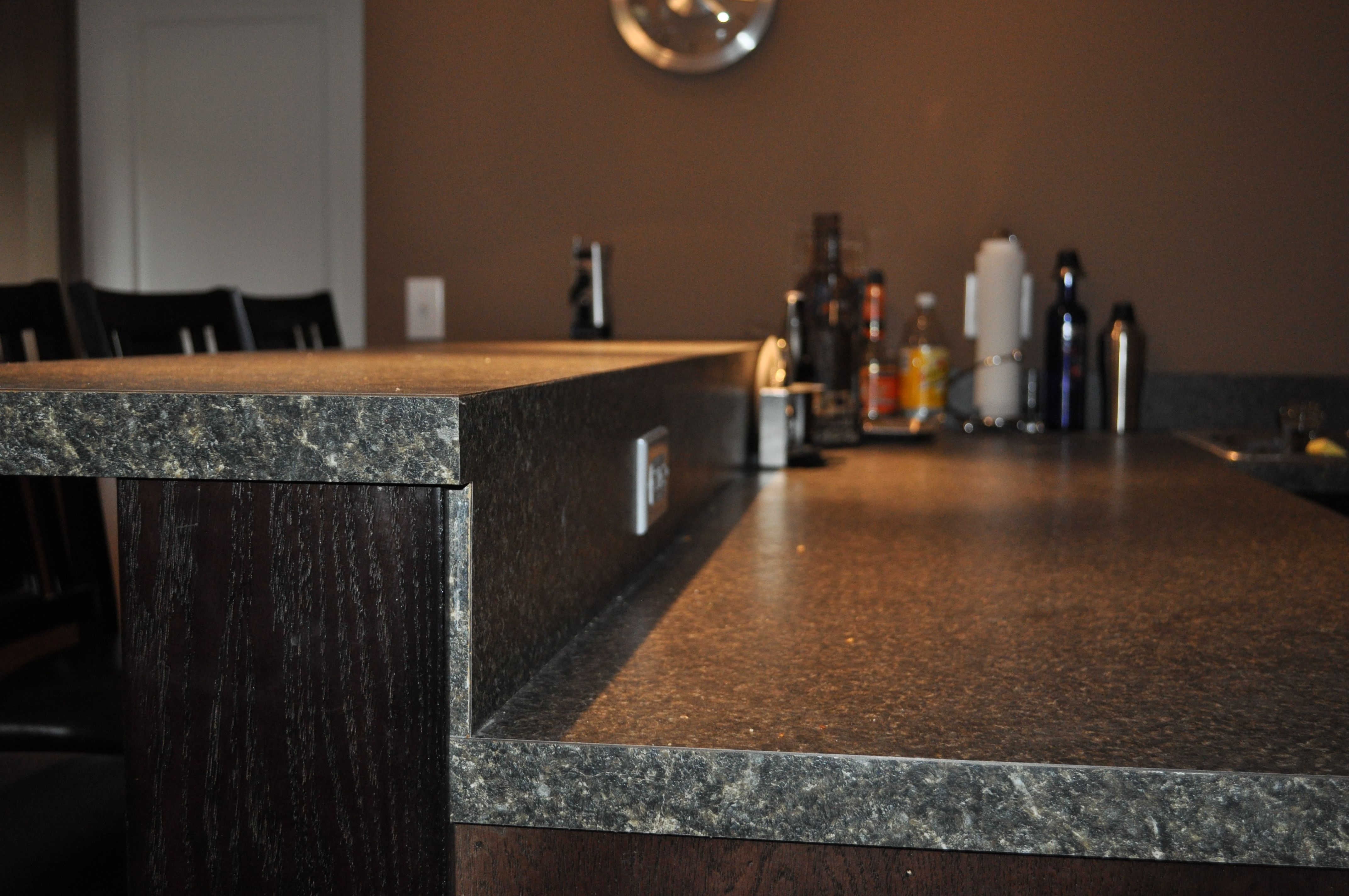 Bar Countertop With Backsplash Ran Flush To Raised Countertop With