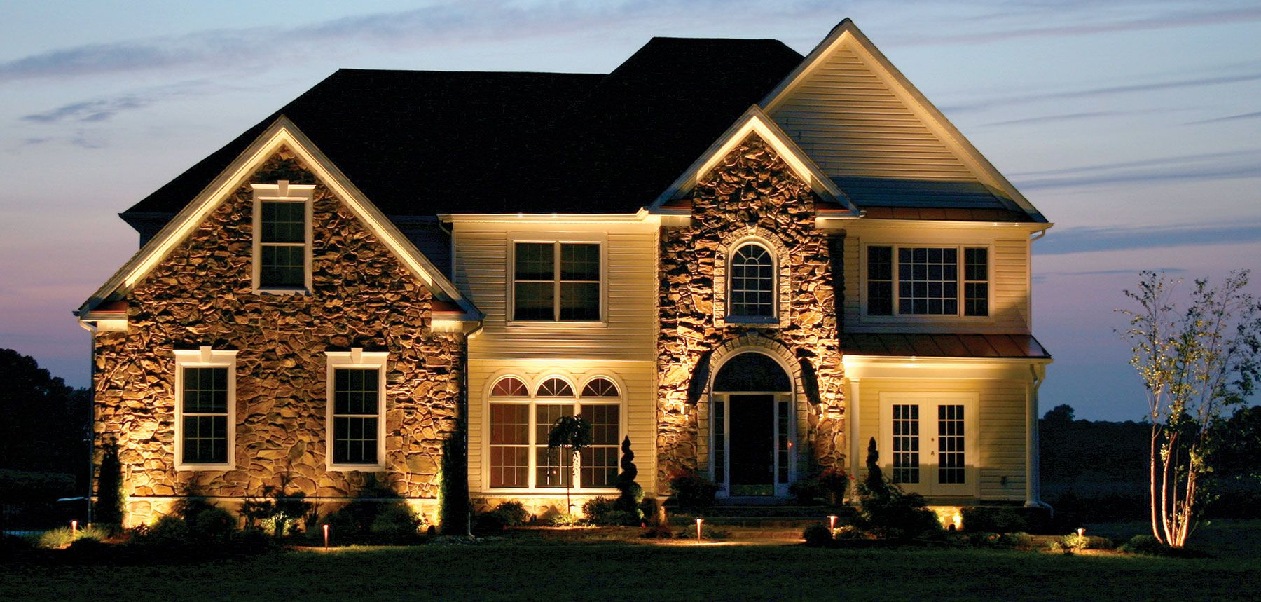 Outdoor Lighting Perspectives Design Experts First Focused On The Stacked  Stone Veneer Using Architectural Highlighting With