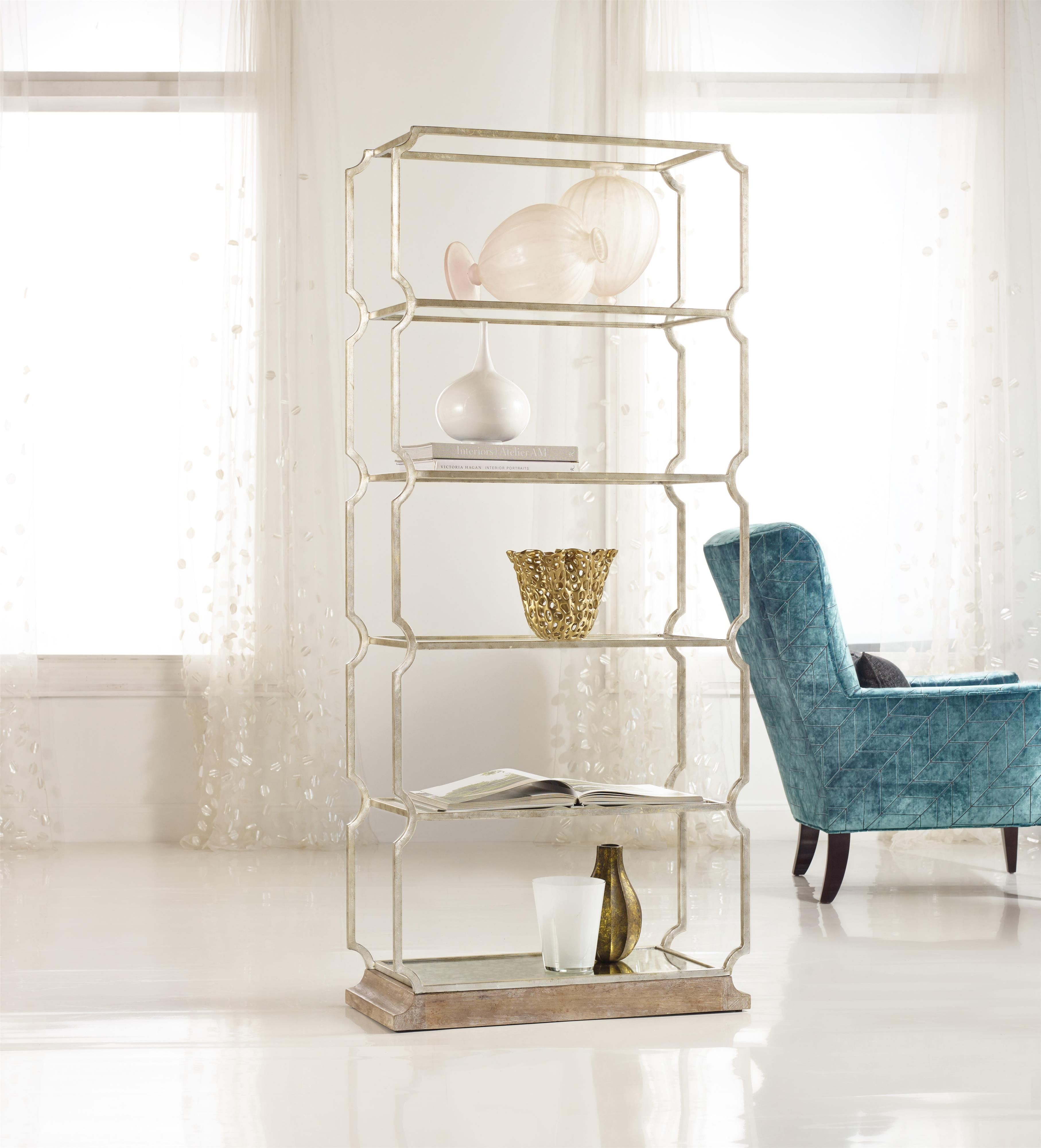 Rustic yet elegant, the Carter metal etagere offers stylish display space. The piece has a cast iron frame with wood base for a vintage look. Use the piece in any room for an eclectic, one-of-a-kind accent.