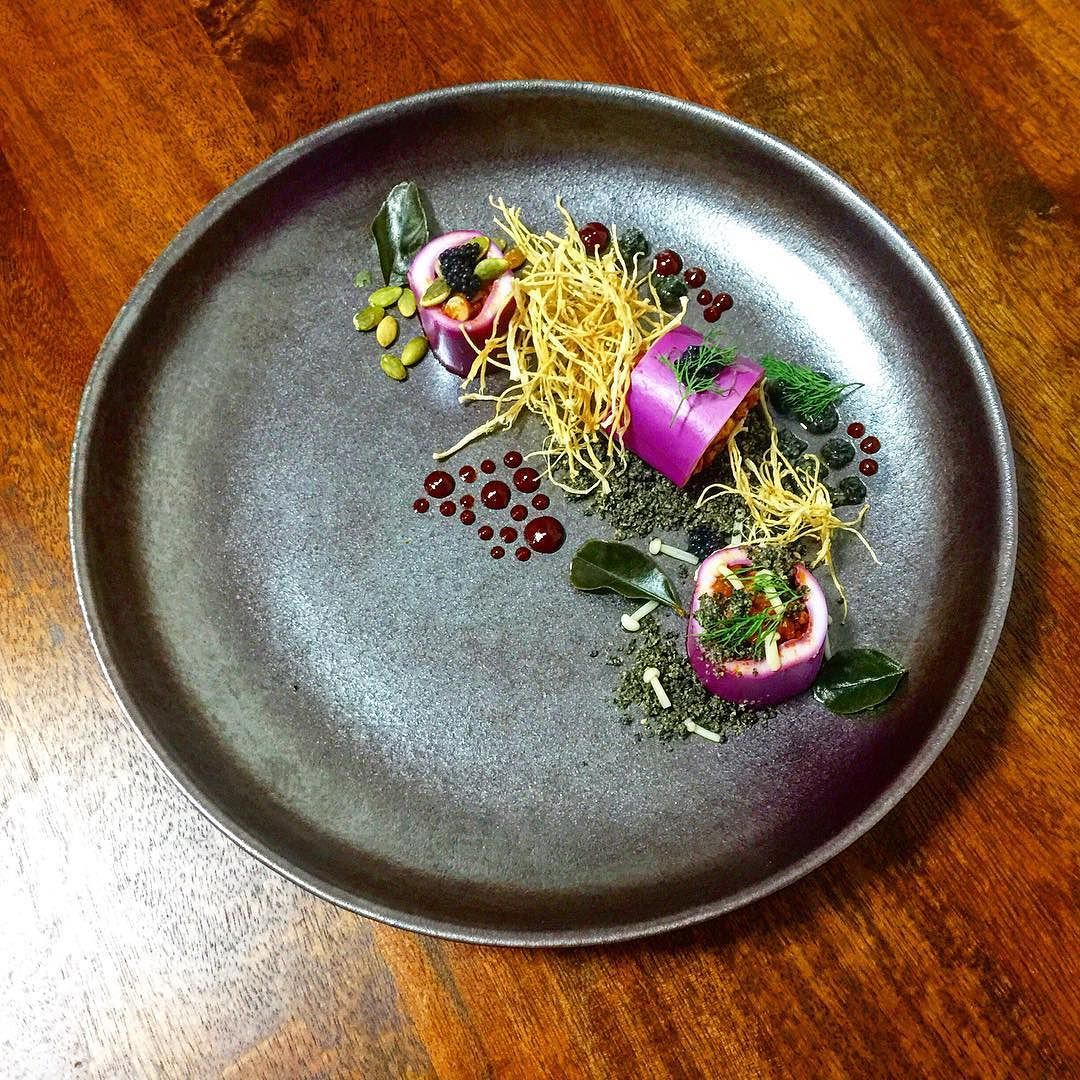 "#homecooked #홈메이드  Red cabbage cured southern calamari(stuffed with its legs kimchi and prawn) with textures of enoki toasted sesame powder sweet & sour chiili sauce and nori mayonnaise. ""Red cabbage cure"" idea from @chefjasonhoward.  적양상추에 재운 후 다리와 새우 김치를 함께 볶아서 속을 채운 오징어 팽이버섯 깻가루 초고추장 김 마요네즈. by terryjeon"