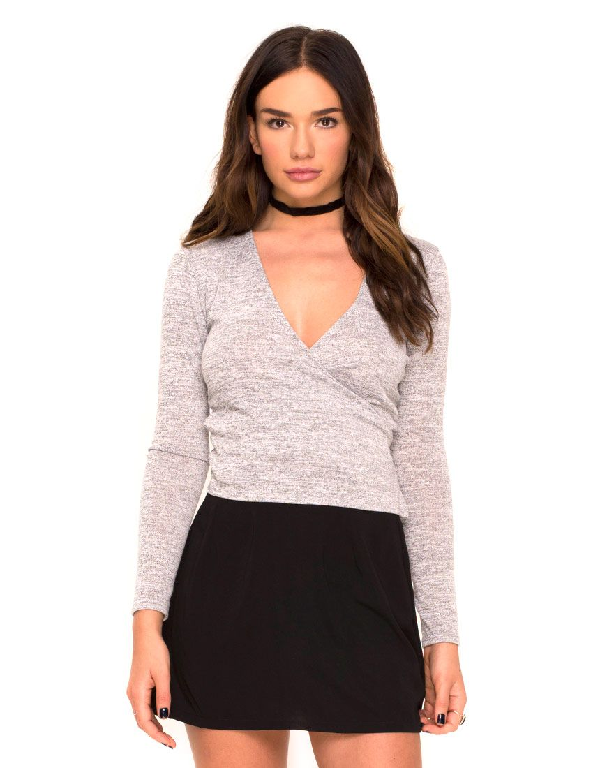 586755cd7b6014 Wrap tops are the flattering shape of the season. This classic long sleeve  crop in a super soft cool grey marl knit jersey features a V-neck line and  side ...