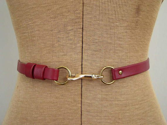 83663ff436a Vintage 1970s cranberry red leather skinny belt with a gold snap clasp hook  buckle. Classic preppy equestrian style. Label  clasp is marked Japan  Condition  ...