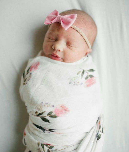 75d0194a63b This pretty pink peony swaddle blanket is a must for your new born baby  girl. The luxurious bamboo swaddle is silky smooth