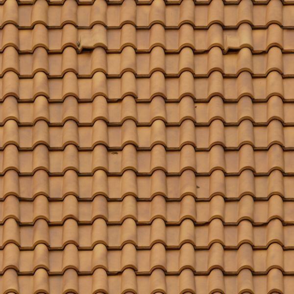 Roofing Made Of New Light Brown Shingles With Rounded Surfaces