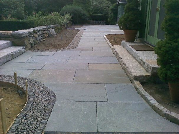 With a thermal bluestone the surface is sawn and then for Blue stone paver patio
