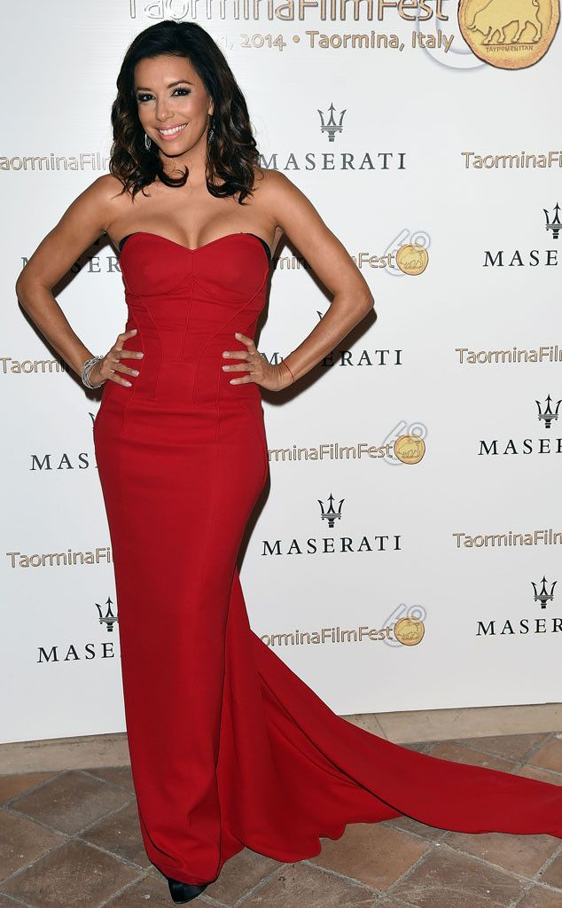 Eva Longoria from The Best of the Red Carpet  Va voom! Eva makes quite the entrance in a crimson curve-hugging Pamella Roland gown at the Taormina Film Festival.