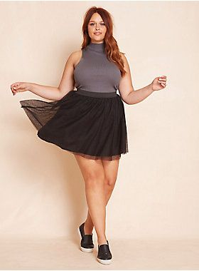 """<div><div>Even if you have two left feet, you won't be able to stop dancing in this skirt. The mini style sports a silky lining to avoid embarrassment on the dance floor, while the black tulle overlay guarantees a """"Cinderella"""" moment. A stretchy waistband lends extra poof.</div></div><div><ul><li style=""""LIST-STYLE-POSITION: outside !important; LIST-STYLE-TYPE: disc !important"""">Size 1 measures 17 1/2"""" from center front</li><li style=""""LIST-STYLE-POSITION: outside !important; LIST-STYLE-TYPE…"""