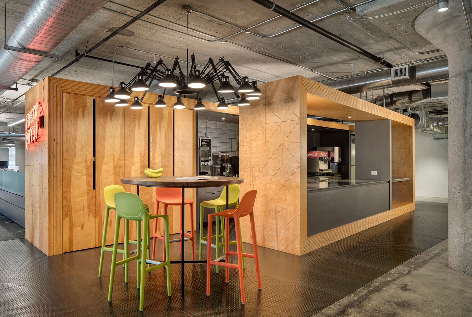 Broom stools, designed by Philippe Starck and made of reclaimed waste, at  the offices of Mailchimp in Atlanta. Architect: ASD I SKY