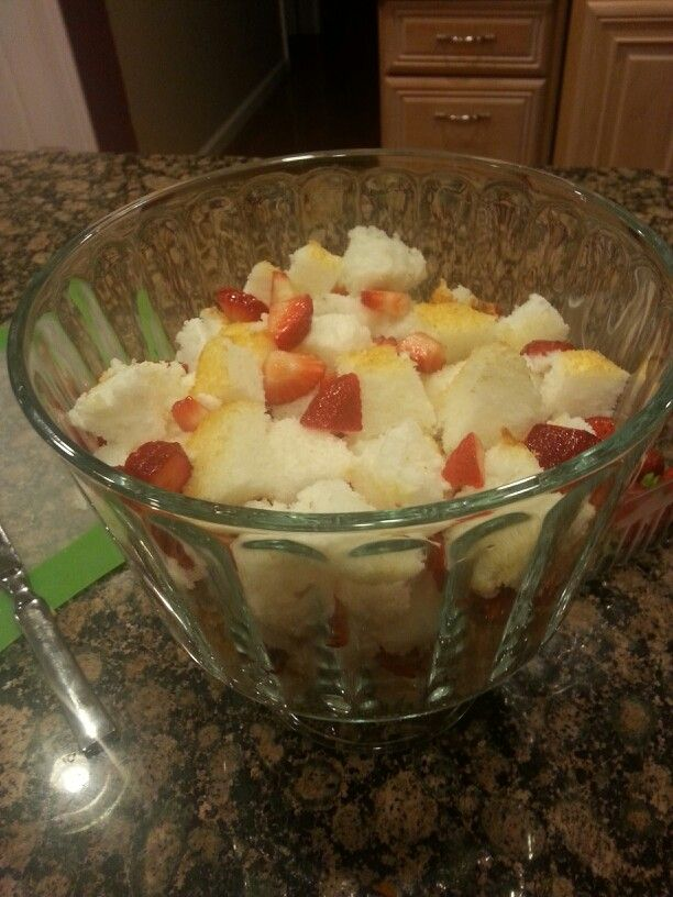 Cubed angel food cake with sliced strawberries!  Yum!!
