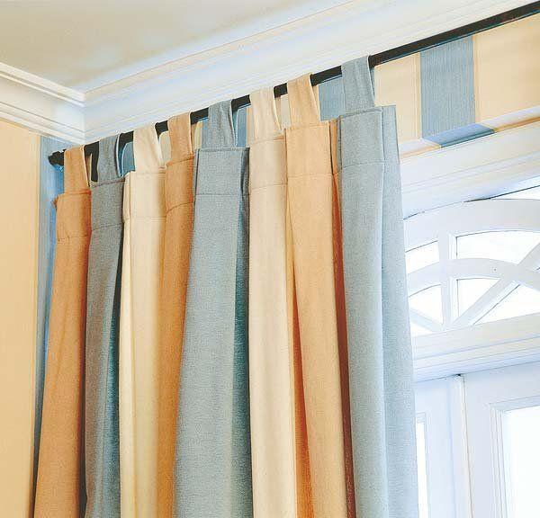 que tal unas cortinas con paños de diferentes colores? ah! y