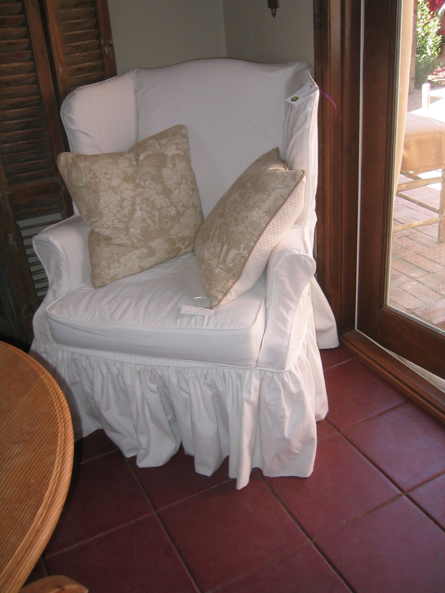 Wing chair slipcovered in white duck