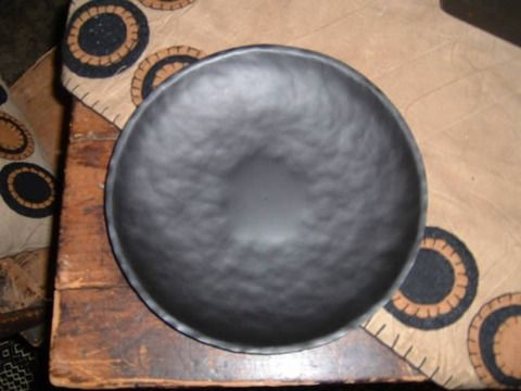 Candle pan on a penny rug....