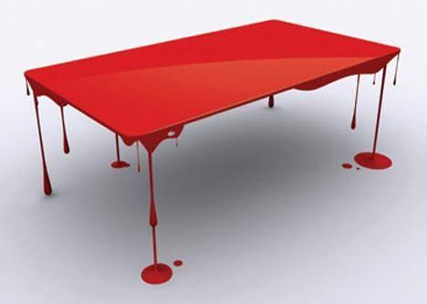 """Para quem gosta de decorações tenebrosas, a mesa de sangue feita pelo designer John Nouanesing, """"Paint Or Die But Love Me"""", parece que flutua. Apesar da aparência, o design é muito bem elaborado."""