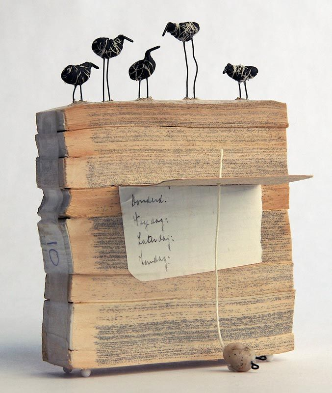 emMorning Resolutions/embr / Book fragments, polymer clay, wire, string, PVA glue, 5.5 x 4 x 3 inches, 2006