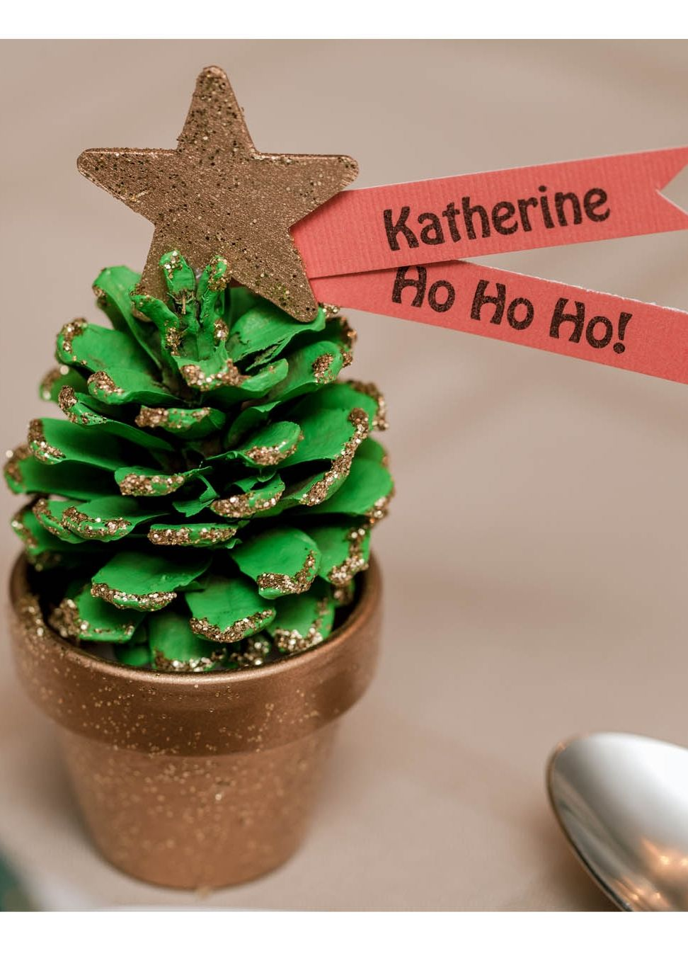 Christmas Quick Craft Pinecone Place Setting | Christmas Tree Place Setting | Find pine cone craft ideas from @joannstores