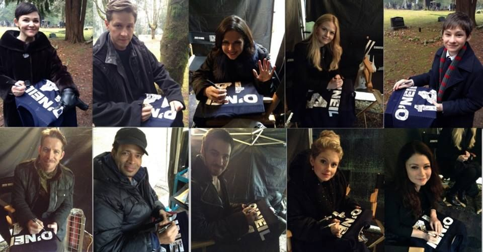 """The OUAT cast signing the """"Traveling Jersey""""."""