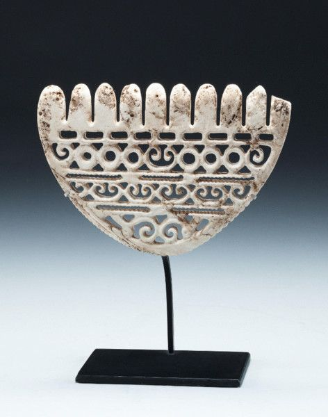 A carved clam shell (Conus Gigantis) wealth object from the Solomon Islands, Melanesia.