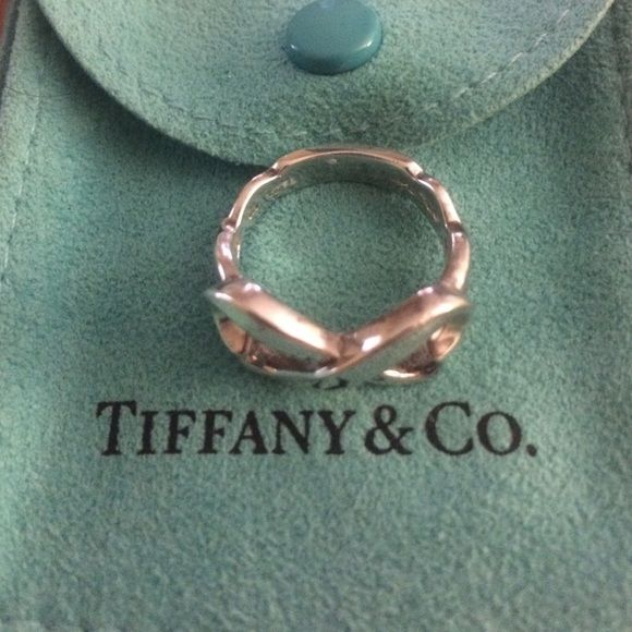 Tiffany and Co authentic infinity heart ring Tiffany and Co authentic infinity heart ring. Few scratches from wear. No trades. Tiffany & Co. Jewelry Rings