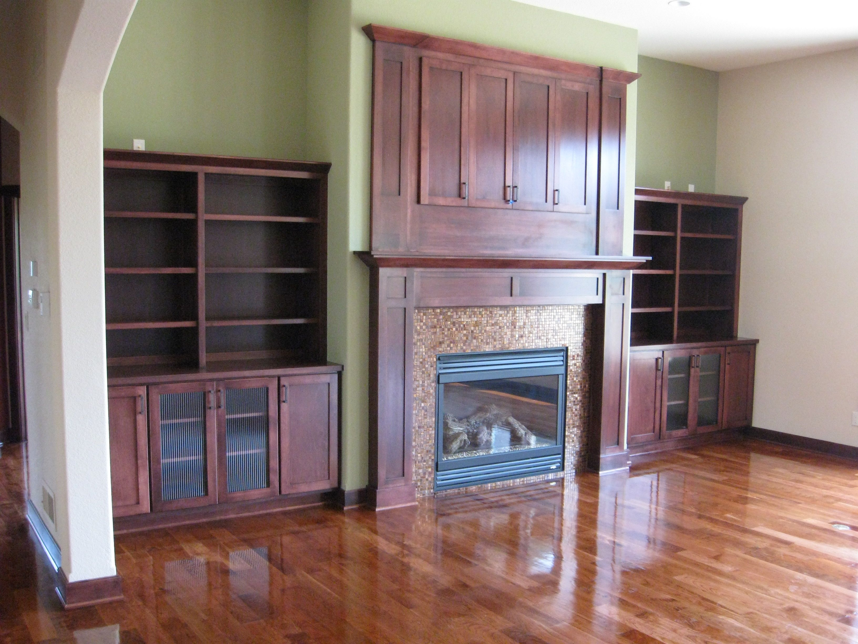 Having built in shelving and cabinets on each side of the fireplace