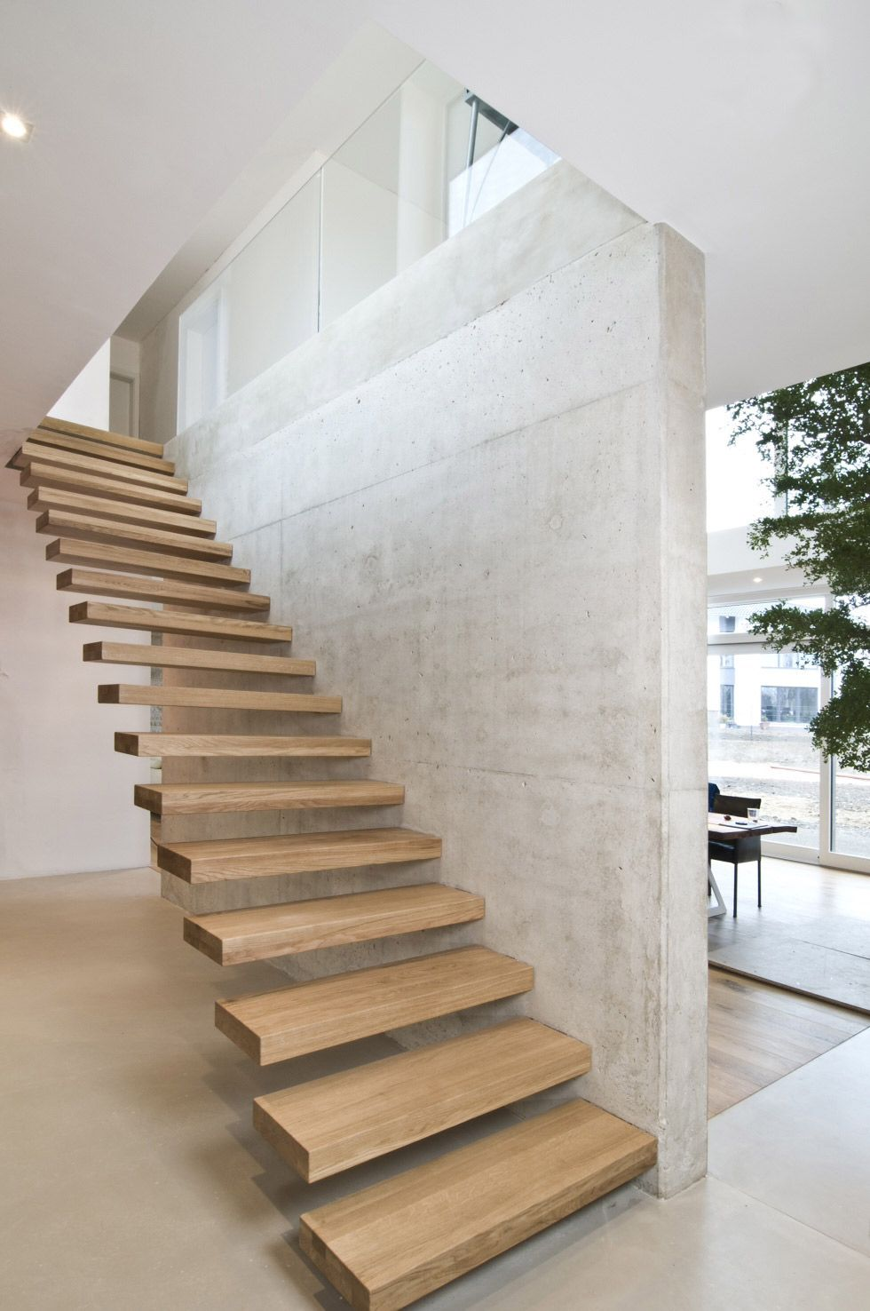 Cantilevered stairs floating stairs need handrail for Floating stairs