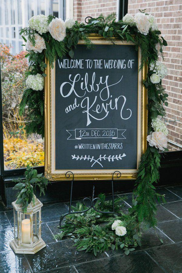 elegant chalkboard sign with wedding hashtag