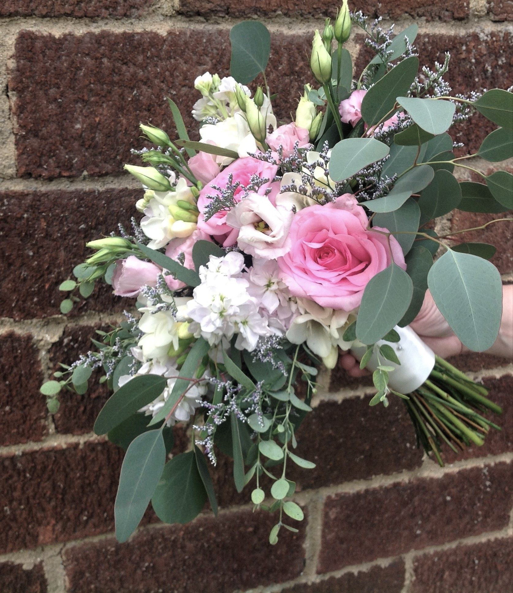 spring or summer wedding bouquet. designed with pink roses, white