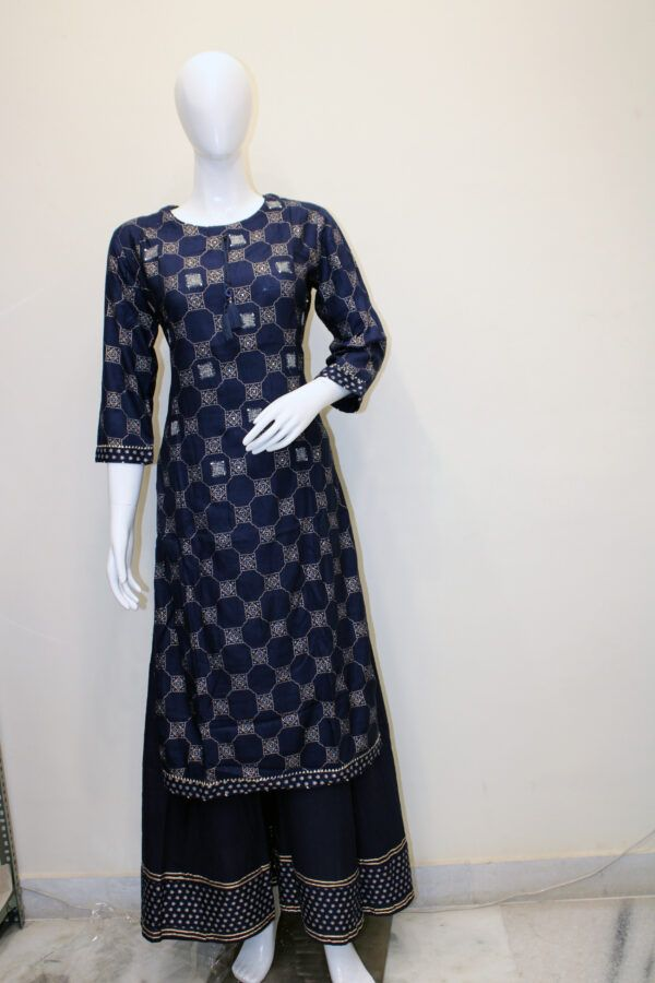 COLOUR: Dark Blue MATERIALS: Rayon CARE: Gentle Hand Wash Size Guide: Bust – S (38), M (40), L (42), Xl (44), Xxl (46), Check Our Size Chart Before Oreder To Get Perfect Kurti According To Your Measurements. Dark Blue Rayon Embroidered Kurta with all over prints. Dark Blue Rayon Big Plazo with elasticated waist.