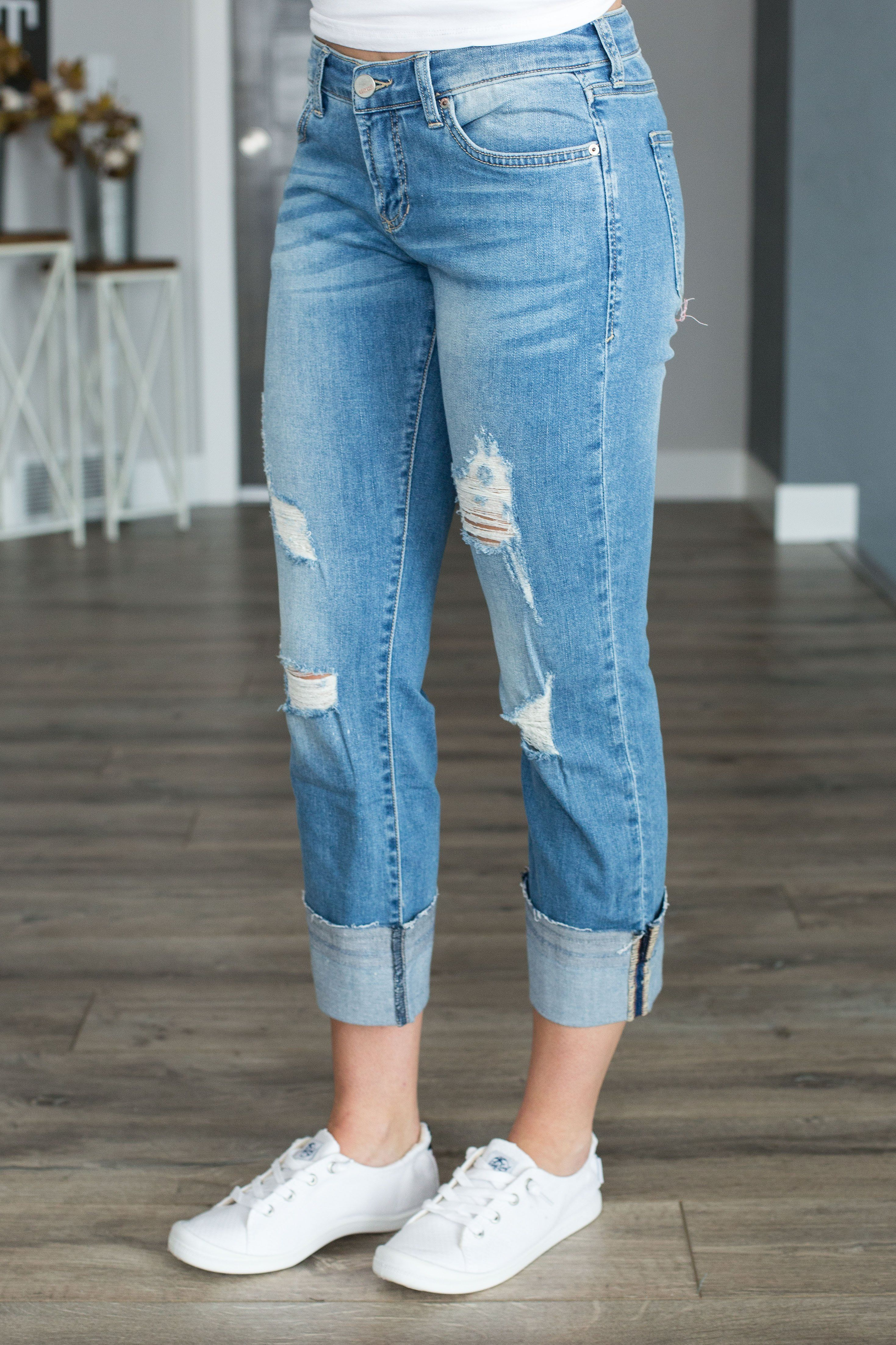 647db1d5fbb286 Light wash boyfriend jean with a relaxed fit, exaggerated cuff and light  distressing. Runs