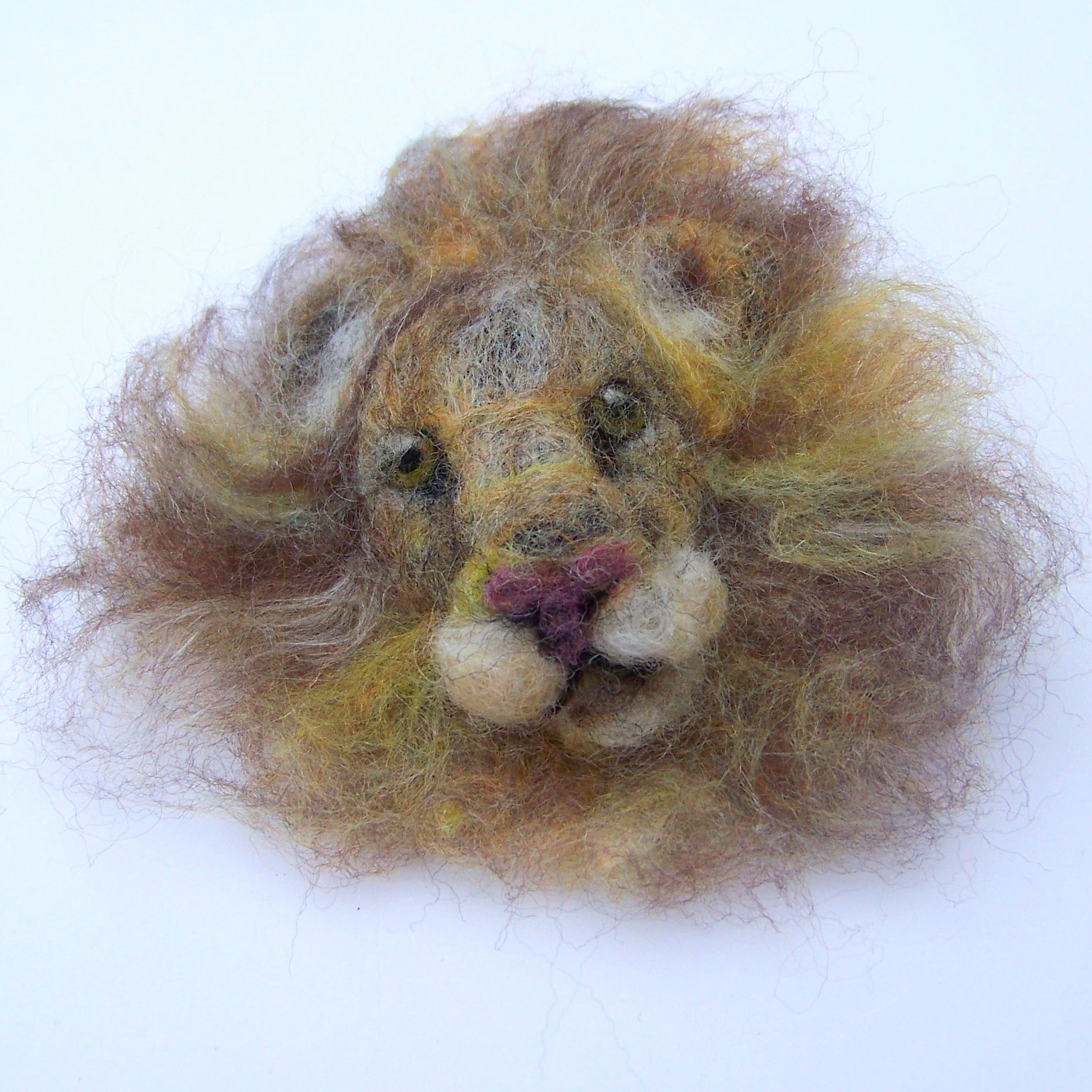 Needle felted lion brooch made with 100% British wool by Felt Artist Eve Marshall.